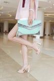 Closeup charming legs and handbags Stock Image