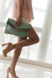 Closeup charming legs and handbags Stock Photos