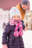 Closeup of Charming little girl enjoys skating Stock Photo