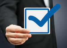 Closeup of checkbox and blue mark in it Royalty Free Stock Image