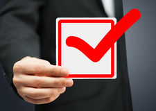 Closeup of checkbox and red mark in it Royalty Free Stock Image