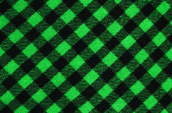Closeup on checkered tablecloth wool fabric. Royalty Free Stock Image