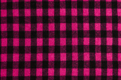 Closeup on checkered tablecloth wool fabric. Stock Image
