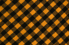 Closeup on checkered tablecloth wool fabric. Stock Photos