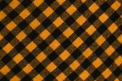 Closeup on checkered tablecloth wool fabric. Stock Photos