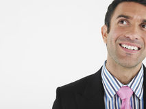 Closeup Of Cheerful Businessman Looking Up Stock Photos