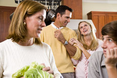 Closeup cheerful family in kitchen conversing Royalty Free Stock Images