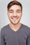 Closeup of cheerful handsome young man looking at camera Royalty Free Stock Image