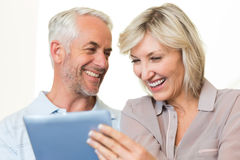 Closeup of cheerful mature couple using digital tablet Royalty Free Stock Photography