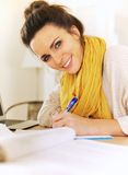 Cheerful Woman Writing in Her Journal Royalty Free Stock Photography