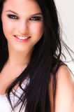 Closeup of a cheerful young woman smiling Royalty Free Stock Photography