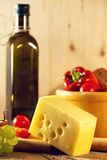 Closeup of a cheese and olive oil bottle Royalty Free Stock Photography