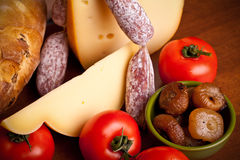 Closeup Of Cheese, Sausages And Grilled Onions Royalty Free Stock Images