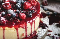 Closeup of a cheesecake covered with mixed berries royalty free stock photography