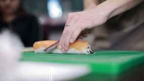 Sushi roll process stock video footage