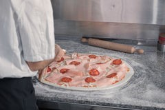 Closeup chef making pizza royalty free stock image