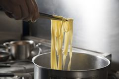 Checking tagliatelle stock images