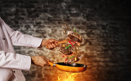 Closeup of chef preparing milled beef meat on grill pan Stock Photos