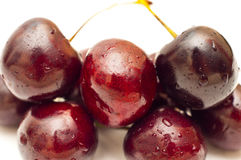 Closeup of cherries with visible droplets Royalty Free Stock Photo