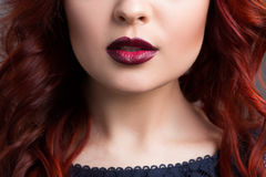 Closeup cherry lips. girl with red hair. the lower Royalty Free Stock Image