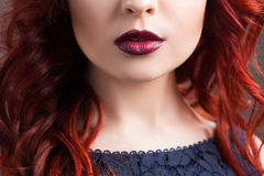 Closeup cherry lips. girl with red hair. the lower Stock Images