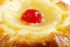 Closeup of cherry topping on Pineapple Danish Pastries Royalty Free Stock Photo