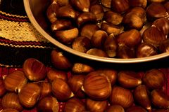 Chestnuts arrangement. Closeup of chestnuts o retro background Stock Photography