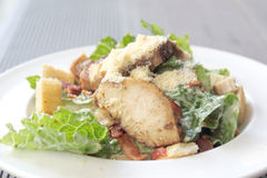 Chicken ceasar salad in a white plate Stock Photo