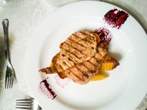 Chicken steak. Closeup of a chicken grilled steak with potatoes and soya souce in decorated plate stock images