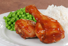 Closeup chicken leg with barbecue sauce and peas Royalty Free Stock Photography