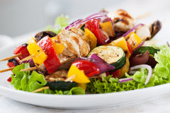 Closeup of chicken skewers or shashlik with grilled vegetables Royalty Free Stock Images