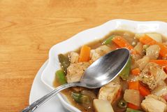 Closeup chicken stew with a spoon Royalty Free Stock Photos