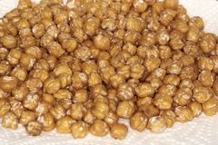 Closeup of chickpeas. Closeup of fried chickpeas, food typical of Mediterranean cuisine Royalty Free Stock Photos