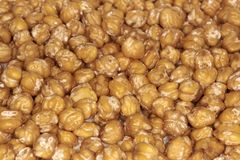Closeup of chickpeas. Closeup of fried chickpeas, food typical of Mediterranean cuisine Stock Images