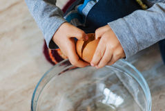Closeup of a child breakable egg, on the floor in a glass bowl. Closeup of a child breakable egg on the floor in a glass bowl royalty free stock photo