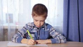 Closeup child doing homework, to do the job, 1080p stock video footage