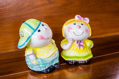 Closeup child dolls on wood Royalty Free Stock Photography
