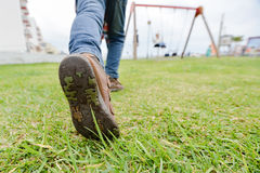 Closeup of child leg and boot sole on grass Royalty Free Stock Image