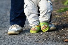 Happy feet - parent and child on the walk stock photography