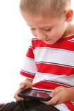 Closeup child plays games on the mobile phone Stock Photos