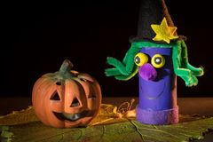 A child`s handicraft witch made of toilet paper rolls and a clay royalty free stock photo