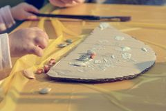 Closeup of child`s hands playing with natural materials in kindergarden. royalty free stock photo
