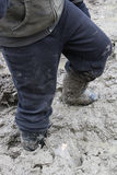 Closeup of a child walking in thick mud Royalty Free Stock Photo