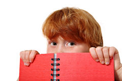 Closeup of childl with notebook Royalty Free Stock Photography