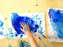 Closeup of children hands painting during a school activity - ice painting - learning by doing, education and art, art therapy stock image