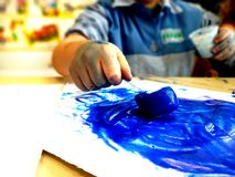 Closeup of children hands painting during a school activity - ice painting - learning by doing, education and art, art therapy royalty free stock images