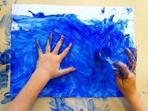 Closeup of children hands painting during a school activity - ice painting - learning by doing, education and art, art therapy. Concept royalty free stock photos