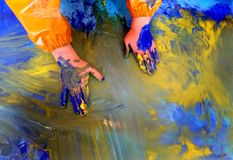 Closeup of children hands painting during a school activity - learning by doing, education and art, art therapy concept.  royalty free stock photos