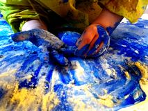 Closeup of children hands painting during a school activity - learning by doing, education and art, art therapy concept royalty free stock image