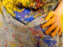Closeup of children hands painting during a school activity - learning by doing, education and art, art therapy concept.  royalty free stock photo
